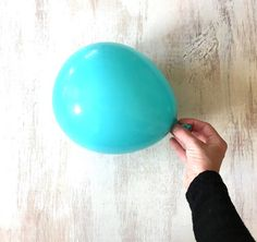 She brushes buttons on a balloon and watch what happens when she pops it... gorgeous gift idea!