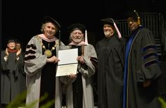 Berklee College of Music President Roger Brown, Lawrence Simpson and Kris Kristofferson confer an Honorary Doctor of Music Degree on WIllie Nelson during the 2013 Berklee College Of Music Commencement Ceremony at Berklee College of Music on May 11 in Boston.