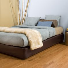 Instant platform bed--by using a Boxspring Cover-Great idea when u don't have or need a frame, and still want to keep your box spring.