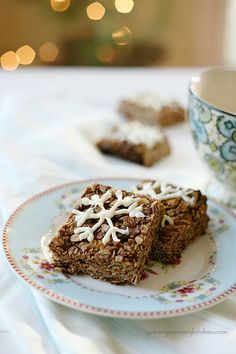 Gingerbread Granola Bars  makes 16 bars   2 cups rolled oats   1/2 cup whole wheat flour 1 teaspoon ground cinnamon  1/2 teaspoon ginger 1/2 teaspoon nutmeg  1/8 teaspoon cloves  1/2 teaspoon sea salt  1/4 cup brown sugar  1/2 cup melted coconut oil  1/4 cup molasses  1/4 cup agave  1 teaspoon vanilla extract  1/4 cup dried cranberries or cherries  1/2 cup toasted chopped pecans, pistachios, or almonds   1 cup vegan white chocolate chips (optional)   Preheat the oven to 400 degrees F. Line a…