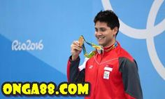 Joseph Schooling wins Olympic gold in butterfly at Olympic Games Joseph Schooling wins Singapore's first Olympic swimming medal, breaks Michael Phelps' Olympic record in the butterfly. Joseph Schooling, Michael Phelps Olympics, Olympic Records, Olympic Swimming, Us Olympics, Olympic Athletes, University Of Texas, Olympians, Olympic Games