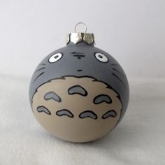 This is a hand painted ornament inspired by Totoro!  Painted on a 2.5 inch glass ball ornament. These are our designs and are all individually painted in acrylic and ink pens. The paint has been sealed with a polyurethane spray.  Custom orders of other anime/manga characters welcome! Please i...