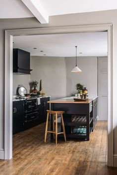 A view into deVOL's Mill House Showroom, original wooden floorboards and simple black Shaker kitchen cupboards Wood Floor Kitchen, Kitchen Stools, Kitchen Cupboards, Kitchen Flooring, Wood Flooring, Home Decor Kitchen, Rustic Kitchen, Kitchen Interior, New Kitchen