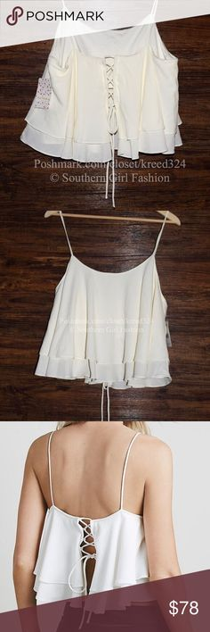 FREE PEOPLE Top LaceUp Cutout Back Crop Swing Tank Available Sizes: M, L. New with tags. $78 Retail + Tax.   • Beautiful double layered tank top featuring lace up detailing at back w/ adjustable ties &  swingy silhouette.  • Built-in shelf bra is stretchy & not sheer.  • Thin spaghetti straps are not adjustable. • Polyester, spandex. • Measurements have been provided in the comment(s) section below.  {Southern Girl Fashion - Closet Policy}   ✔️ Same-Business-Day Shipping (10am CT). ✔️ Price…
