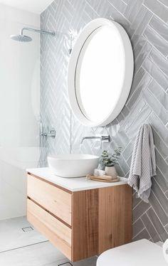 Grey herringbone subway tile on modern bathroom with floating vanity, white vessel sink and round mirror Diy Bathroom, Bathroom Trends, Bathroom Flooring, Bathroom Ideas, Mirror Bathroom, Bohemian Bathroom, Remodel Bathroom, Bathroom Remodeling, Wall Mirror