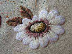 Threads and patches: The finish of a huge daisy
