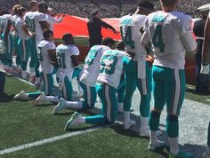 Several Dolphins kneel for national anthem, Seahawks link arms | theScore.com