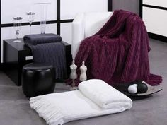 knitted throw blankets in white, gray and dark purplish red colors