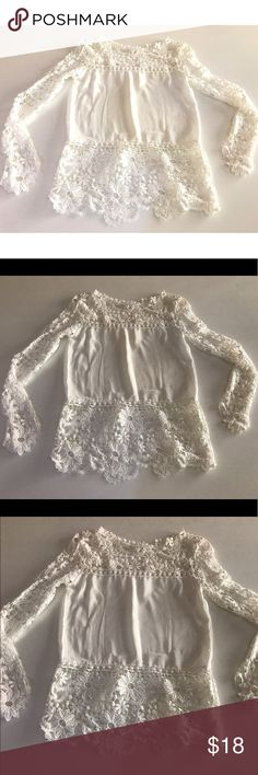 White Crotchet Blouse Despite the tag saying it's S. I almost had a near death experience getting in and out of this. I'm a small and this couldn't even fit me so i'm thinking it's a XS or XXS. Such a beautiful blouse but i've never had the ability to use it! Never worn. No signs of wear. No marks. No scratches. No stains. Good as new Tops Blouses