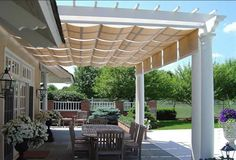 Pergola with retractable canopy.  I like the idea of multiple shades so you could have some sun and shade.