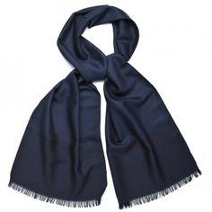 Elegant wool/silk scarf wih a discrete woven pattern.
