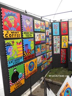 Photo of an array of whimsical block prints on display at the Talbott Street Art Fair in Indianapolis