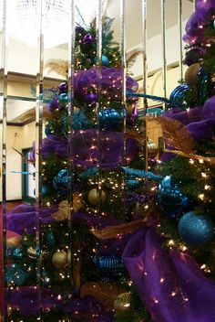 Purple Christmas tree, via Flickr. Caroline would love this look ; peacock colors
