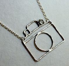 :-) a camera pendant. I love photography and adore jewellery. via Jerlene Richman