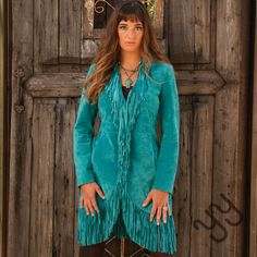 Fall for fringe with this Long Fringe Turquoise Jacket by Scully.