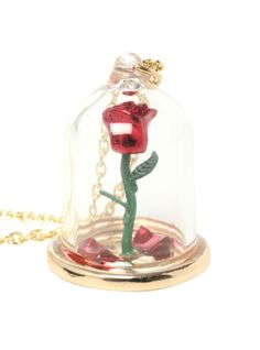Gold tone chain necklace with rose under glass pendant. I want this