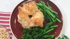 As the nation continues to try and work off those festive treats, we're turning to Olympian Tom Daley to help get us back into shape. He's swapped the diving board for the chopping board as he whip us up some healthy chicken, mozzarella and pesto filo parcels.  Recipe taken from Tom's Daily Plan by Tom Daley