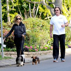 GOLDIE HAWN & KURT RUSSELL    Hawn and longtime love Russell split up puppy patrol while taking a walk around their Brentwood, Calif., neighborhood