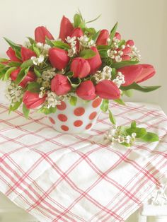 Spring arrangement made with tulips and pear blossoms/vintage polka dot vase