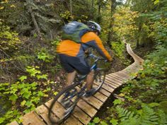 Mountain biking on the Stairway to Heaven Trail, Copper Harbor, Michigan, USA Photographic Print by Chuck Haney at Art.com