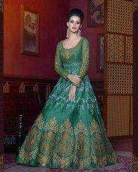 1. Dark green silk floor length anarkali suit 2. Floral zari embroidery work all over the anarkali 3. Comes with a matching shantoon bottom and net dupatta 4. Can be stitched upto bust size 42 inches