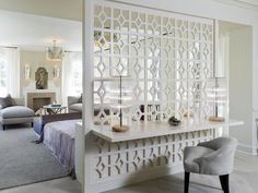 This room divider not only separates the master bedroom and sitting area from the bathroom, it also doubles as a headboard.