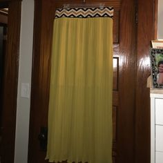 Pleated mustard colored maxi skirt with Aztec band Pleated maxi skirt with elastic Aztec band at waist. Size XL but stretched to my 2x waist. Worn once. Great condition. Great skirt. Wore it with a flat sandals and a white tank for an effortless look. Approx 43 inches from band to hem. Skirts Maxi