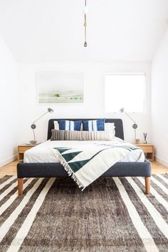 Boho Cali bedroom with grey bed and layered textiles