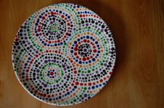 What a cool plate!  You could make a set!  www.paintyourownpottery.com