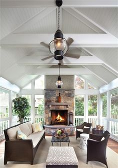 The details of a luxurious porch interior resonate with the Victorian-era attributes of the main house.