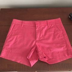 UNIQLO pink shorts Worn once! UNIQLO pink shorts size 2. In perfect condition. 97% cotton 3% spandex. Color is a rusty pink (pictures were coming out slightly brighter than actual color). Hidden pockets on the back. UNIQLO Shorts
