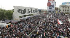 Followers of Iraq's Shi'ite cleric Moqtada al-Sadr gather and chant slogans during a protest demanding that parliament approves a long-delayed new cabinet and end political and sectarian wrangling that is hampering a vote on the matter, at Tahrir Square in Baghdad April 26, 2016
