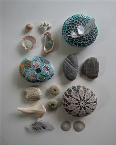 I don't what I think of this, but there they are, crochet on pebbles and rocks!