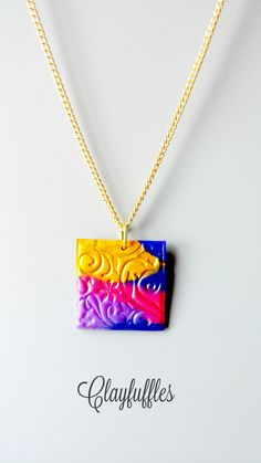 "NEW!! Very Sweet and Very Colourful! This handmade Polymer clay necklace was made with Blue, Pink, Purple and Yellow clay. Designed, baked and sealed for protection.  It sits in a square stainless steel bezel which measures 1"" x 1"". It is on a lovely silver plated chain link chain and you have your choice in what length you would like the necklace to be, free of charge! $15 https://www.etsy.com/ca/listing/265417553/polymer-clay-necklace-multi-colour-clay?ref=shop_home_active_21"