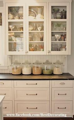 I love this idea, however, I do not love the idea of having to keep my cabinets looking organized all the time...although being able to showcase my rotating collection of cereal does have it's appeal :)