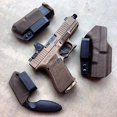 Glock 19 Gen4 FDE (flat dark earth) 9mm semi automatic pistol with Trijicon RMR sight paired with a KA-BAR TDI law enforcement knife