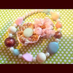 Infant/toddler/kids neckless and matching hairbow Baby's first jewelry. This set also comes with a matching bracelet. I can post more pics if needed. This set is adorable with Pretty pastel colors. This awesome combo has a vintage flair!! Perfect for newborn to toddler phot shoot. Jewelry