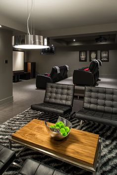 This contemporary media room by Just Basements in Ottawa is chic and masculine. Great design without the fuss!