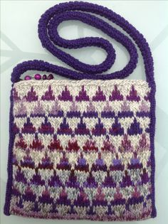 Knitted purse using 'magic ball 'in purple yarns. Debbie Irving