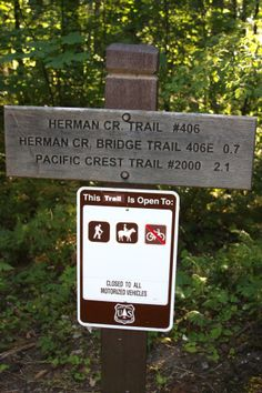 At the entry to the Herman Creek trail, Columbia Gorge, OR.   I'm glad they don't make these signs out of metal.  The wooden signs fit better with the landscape and is probably why they do it this way.  08/2013.