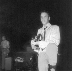 """A rare photo of Elvis backstage at his first big live performance, only weeks after recording """"That's All Right"""" on July 5, 1954. This was at the Overton Park Shell in Memphis, on July 30, 1954. I recently just visited Memphis and sought out the Shell, which is still there and in use"""