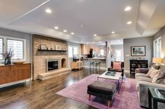 A grand fireplace is the focal point of the first floor living space at this home for rent in Lakeview.