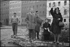 Looking into East Berlin, family members from the west wave to one another near the French sector of East Berlin, November 1961.