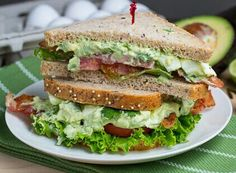 GUACAMOLE SANDWICH - Ripe avocados / Leaf lettuce, washed / Tomato, sliced / Cheese, sliced - Cheddar, Swiss, or Monterey Jack work best but use your favorite / Bread - use your favorite, mine is Wheat Berry (I love the seeds and nuts) / Lemon juice / Salt to taste /  Mash avocados and add 1 tsp lemon juice for each avocado you use. Sprinkle with salt to taste. Toast bread and spread both with guacamole. Top with cheese, tomato and leaf lettuce. Close and slice. Serve.