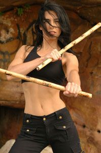 My upcoming new hobby: Escrima. A Pilipino martial art incorporating  such weapons as knives, swords and wooden sticks made of ritan (featured in this photo). Very deadly and, apparently very sexy.