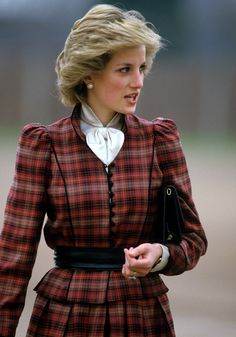 Princess Diana looking beautiful in one of her many Tartan inspired outfits. This one was designed by Caroline Charles. Circa 1985