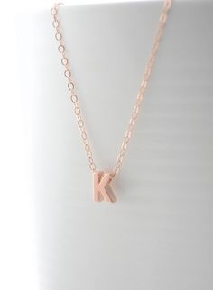 tiny rose gold letter necklace