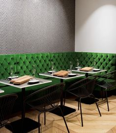 A European-style dessert bar in Melbourne: A striking mosaic wall by Fabian Scaunich from Moasic Republic and rich  green banquettes and couches anchor the boutique's high tea salon at  the rear of the store.