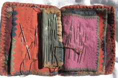 antique needle book. looks like the edges were sewn with whatever thread was left on a needle.