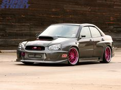 Custom Subaru Impreza... dig those rims with having some lip! Clean monotone scooby body with bright accents work give it just the right amount of punch.